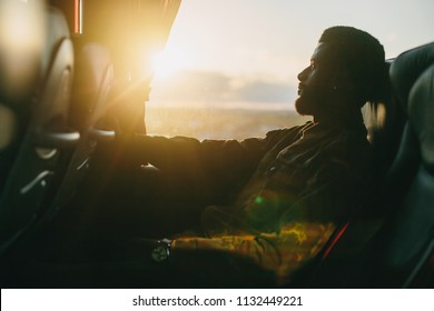 Traveler man traveling in intercity bus, look to the window