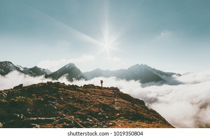 Traveler in mountains clouds landscape Travel lifestyle adventure concept summer vacations outdoor scale showing view