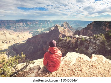 Traveler on cliff mountains over Grand Canyon National Park, Arizona, USA.Inspiring emotion. Travel Lifestyle journey success motivation concept adventure  vacations outdoor concept.