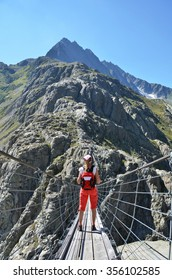 Traveler on theTrift bridge. Switzerland