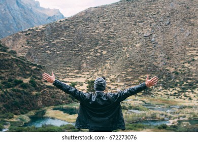 Traveler opening arms over the canyon in Andes, Huancaya Peru