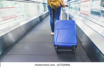 Traveler pull suitcase walking on express way at airport with motion blur effect,Travel concept
