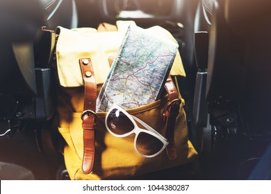 traveler relax holiday concept, view planning way road in trip vacation, hipster hiker tourist yellow backpack closeup, navigation map europe on background auto car transport, trip in transportation