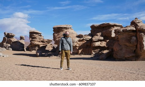 Traveler and rocks near to the stone tree in Bolivia.