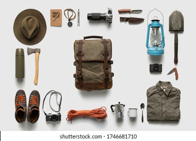 Traveler set on white background isolated. Packing backpack for a trip creative concept.