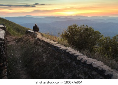 Traveler sightseeing the beautiful scenery of nature during sunset at Nern Chang Suek Mountain, Kanchanaburi province in Thailand.  Travel and natural Concept