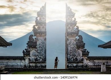Traveler standing at the ancient gates of Pura Luhur Lempuyang temple aka Gates of Heaven in Bali, Indonesia.
