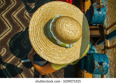 Traveler with straw hat from the top.