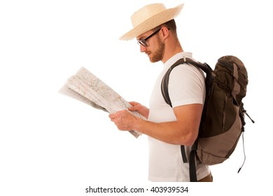 Traveler with straw hat, white shirt, backpack and map seems like he is lost isolated over white background.