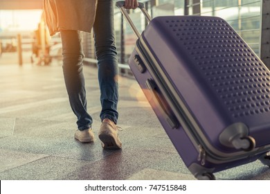 Traveler with suitcase in airport concept. Woman walking with carrying luggage and passenger for tour travel without airport for going to home vacation time in holiday rest and relaxation.