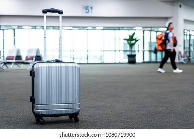 traveler suitcases in airport terminal waiting area