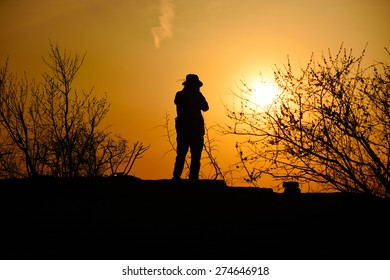 traveler with sunset in dusk, climber silhouette