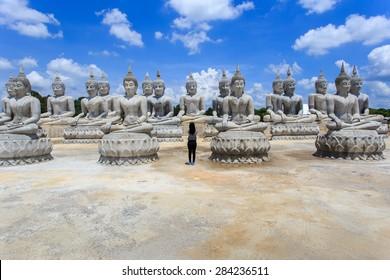 Traveler take a photo with Buddha statue and blue sky, Nakhon Si Thammarat Province, Thailand