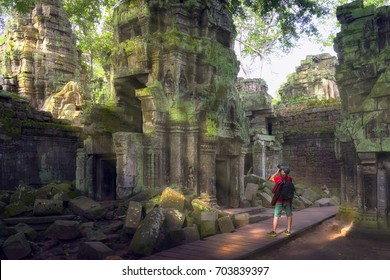Traveler take a photo, Ta prohm temple or Tom rider temple  is on Angkor wat temple area in Siem reap, Combodia, Asia, unesco, amazing, travel and temple concept