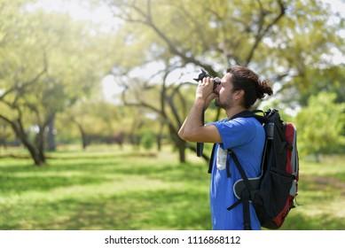 Traveler is taking photos in park