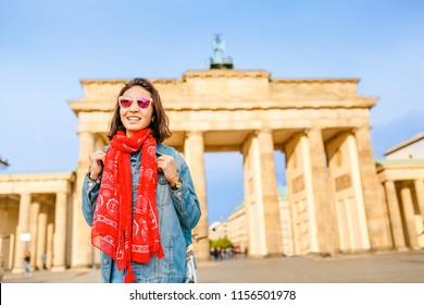 Traveler tourist woman at Brandenburg Gate or Brandenburger Tor at sunset