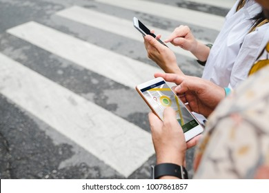 Traveler use map on mobile phone app to search for route location of place with gps on street when travel in city,Technology in lifestyle