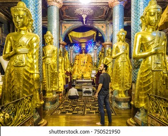 Traveler visiting ancient Shwedagon Pagoda temple in Yangon, Myanmar (Burma).