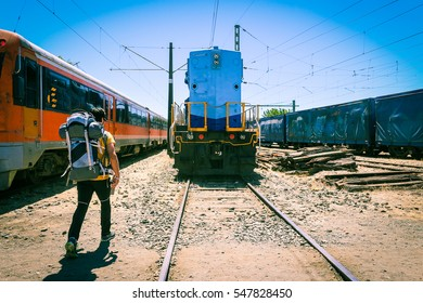 Traveler walking into a train station