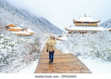 Traveler walking on the snow in Snow season, China