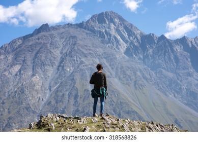 A traveler watching on mountain landscape, by Kazbeg mountain - Kazbegi (Stepantsminda), Georgia