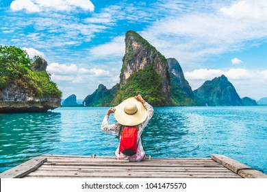 Traveler woman with backpack joy relaxing on wood bridge looking Beautiful destination island, Phang-Nga bay, Travel adventure Thailand, Tourist natural landscape Asia, Summer holiday vacation trip