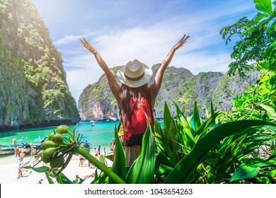 Traveler woman with backpack relaxing on tropical beach forest and joy view natural sea beach, Maya bay, Krabi, Travel Thailand, Beautiful destination place Asia, Summer holiday outdoor vacation trip