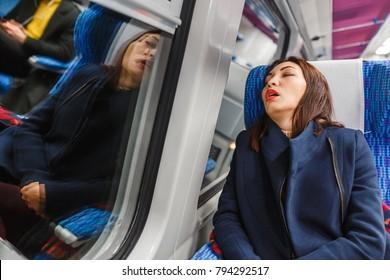Traveler woman funny sleeping in a train