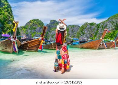Traveler woman hand doing flying shape joy tradition boat on summer vacation beach Maya bay Krabi, Famous landmark tourist travel Phuket Thailand, Tourism beautiful destination place Asia holiday trip