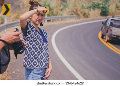 traveler woman in hot summer standing on the road in outdoor nature