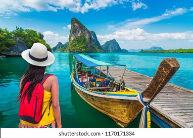 Traveler woman looking beautiful destinations place, Boat for tourist on Phang-Nga bay view Panyee island scenic nature landscape, Travel adventure Phuket Thailand, Tourism Asia holidays vacation trip