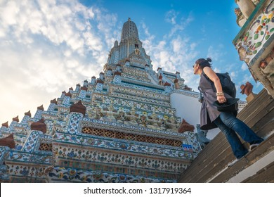 Traveler woman looking pagoda temple unique attractions in Wat Arun, Popular famous landmark travel Bangkok Thailand, Tourist female on holiday vacation trips, Tourism beautiful destination place Asia