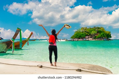 Traveler woman on summer lifestyle joy fun Beautiful natural scenic landscape, Tourist girl relaxing on sunny beach island Travel Phuket Thailand holiday vacation trip Tourism Destination scenery Asia