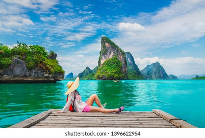 Traveler woman relaxing on wood bridge looking beautiful destination island, Phang-Nga bay, Adventure landmark tourist travel Thailand summer holiday vacation, Tourism natural scenic landscape Asia