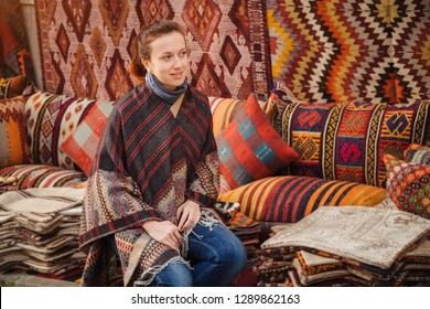 Traveler woman see traditional turkish textile on Grand bazaar in Istanbul, Turkey