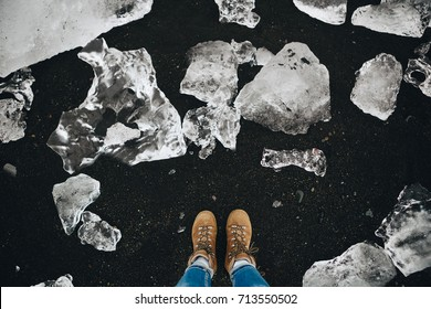 Traveler woman standing on the Jokulsarlon glacier lagoon beach, Iceland. Lifestyle Travel Adventure concept