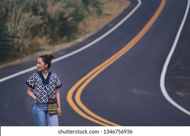 traveler woman standing posing relax on the road in lanna uniform north Thailand
