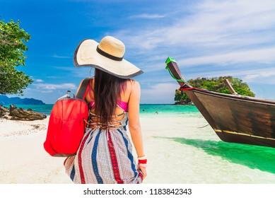 Traveler woman in summer dress joy beautiful natural scenic landscape Lifestyle fashion beauty girl on sunny beach Leisure travel Phuket Thailand holiday vacation trip Tourism Destination scenery Asia