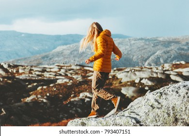 Traveler Woman trail running outdoor in Norway mountains Travel healthy Lifestyle concept adventure wild nature