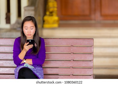 traveler young beauty asian woman sitting at chair and use smartphone