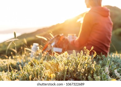 Traveler young woman resting in mountains in spring. Focus on foreground.