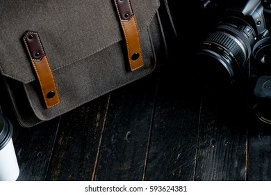 Traveler's accessories and items on black wood