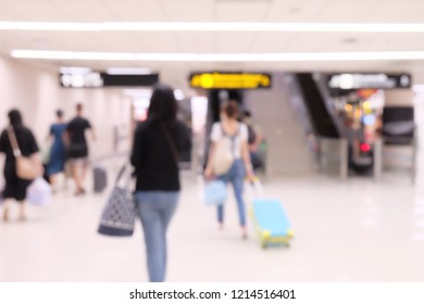 Travelers at airport terminal blur background with bokeh light filter.