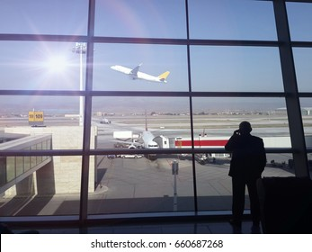 Travelers in airports. businessman in airport and airplane in sky
