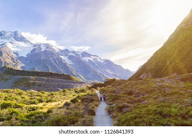 Travelers can seen trekking to the Mount Cook National Park,New Zealand