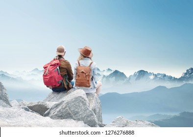 Travelers couple look at the mountains landscape. Travel and active life concept with team. Adventure and travel in the mountains region