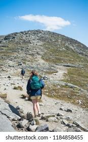 travelers hiking on Besseggen ridge in Jotunheimen National Park, Norway