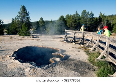 Travelers look at Surprise Pool, Lower Geyser Basin, Yellowstone National Park, United States