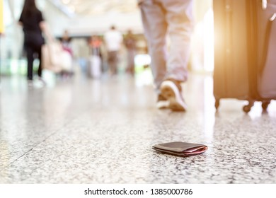 Travelers lost their wallet on the floor at the airport. Losing money while traveling concept. Focus on wallet
