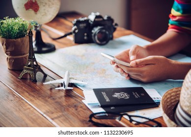 Travelers are planning a trip by searching the route on the map and searching for information on the internet.
